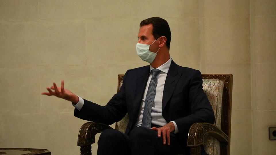 Syria's President Bashar al Assad is seen during a meeting with Russia's Deputy Prime Minister Yuri Borisov and Foreign Minister Sergei Lavrov in Damascus, Syria September 7, 2020. (Reuters)